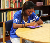 photo of student working at library table